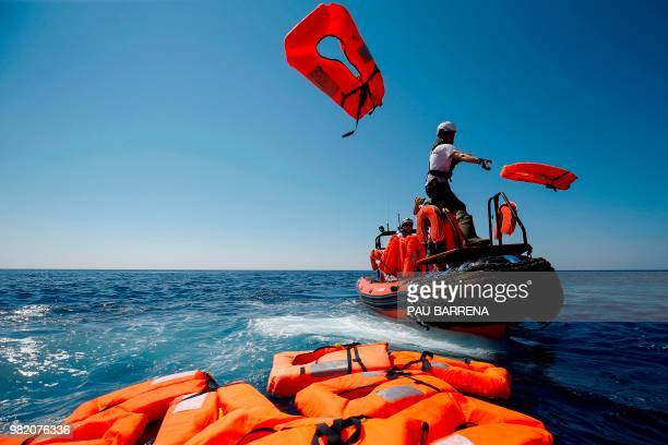 Members of SOS Mediterranee NGO and Doctors Without Borders perform a rescue drill near the Aquarius rescue vessel chartered by French NGO...