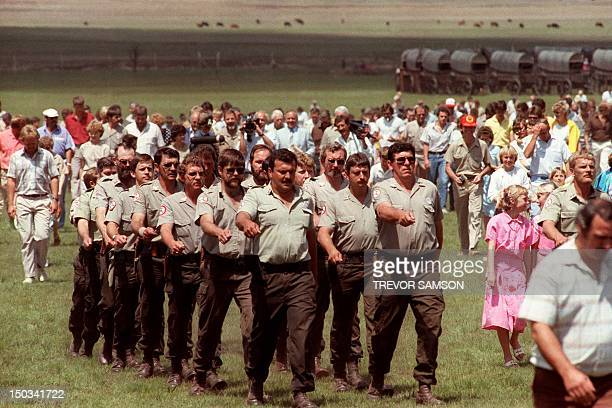 Members of South African selfstyled racist white supremacist Afrikaner Weerstandsbeweging AWB arrive 10 October 1987 in Johannesburg for a meeting...