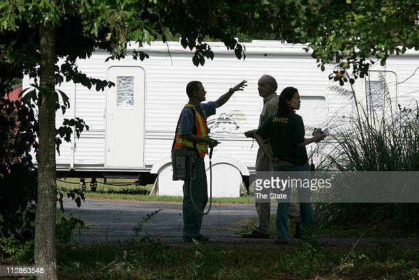 Members of South Carolina Department of Health and Environmental Control emergency response team check a nearby residence for any lingering buildup...