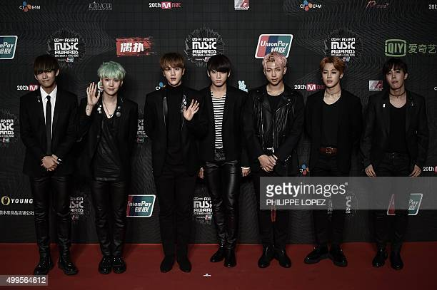 Members of South Korea music band BTS pose on the red carpet of the 2015 Mnet Asian Music Awards in Hong Kong on December 2 2015 AFP PHOTO / Philippe...