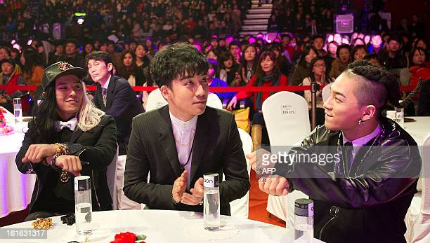 Members of South Korean boy band BIGBANG GDragon Seungri and Taeyang attend 2nd Gaon Chart KPop Awards held in Seoul on February 13 2013 The band won...