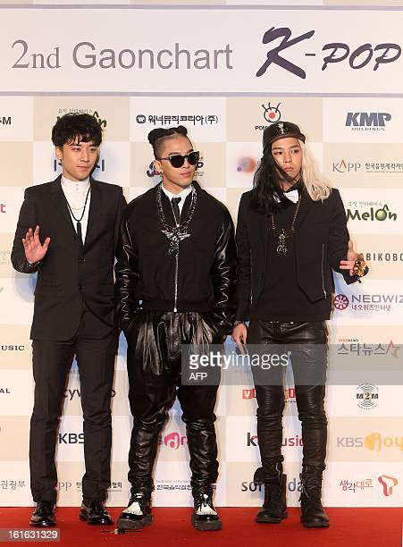Members of South Korean boy band BIGBANG Seungri Taeyang and GDragon attend 2nd Gaon Chart KPop Awards held in Seoul on February 13 2013 The band won...