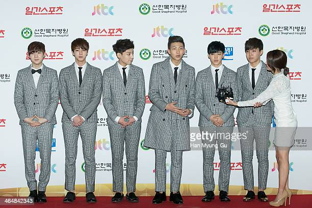 Members of South Korean boy band BTS attend the 28th Golden Disk Awards at Kyunghee University on January 16 2014 in Seoul South Korea