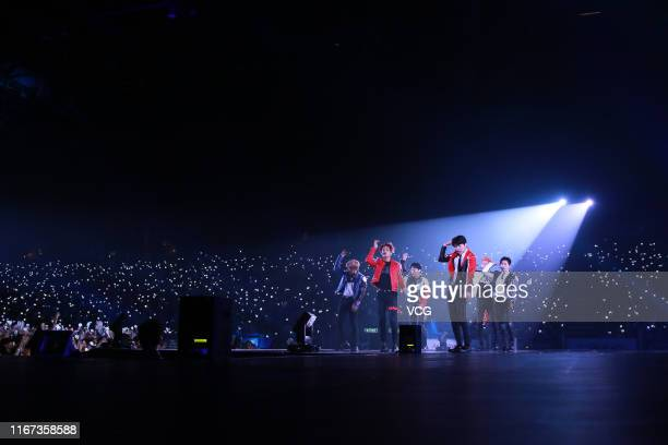 Members of South Korean boy band EXO perform on the stage in concert at AsiaWorldExpo on August 10 2019 in Hong Kong China