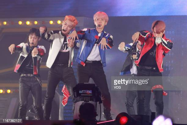 Members of South Korean boy band EXO perform on the stage in concert at AsiaWorld-Expo on August 10, 2019 in Hong Kong, China.