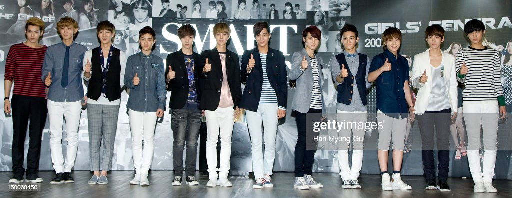 Members of South Korean boy band EXO-K and EXO-M attend during the 'S.M.ART Exhibition' opening ceremony held at Coex on August 09, 2012 in Seoul, South Korea.
