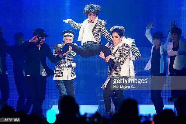 Members of South Korean boy band SHINee perform on stage during the YouTube Music Awards at Kintex on November 3 2013 in Seoul South Korea