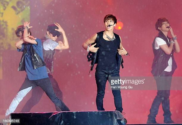 Members of South Korean boy band SHINee perform onstage during at KBS London Olympic Athletes Welcomed The National Festival on August 14 2012 in...
