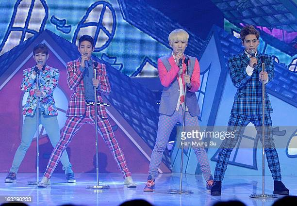 Members of South Korean boy band SHINee perform onstage during the MBC Music 'Show Champion' at UniqloAX Hall on March 6 2013 in Seoul South Korea
