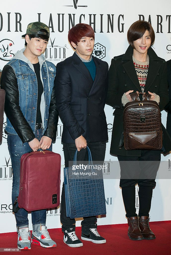 Members of South Korean boy band U-Kiss attend the Moldir Launching Party on January 24, 2014 in Seoul, South Korea.