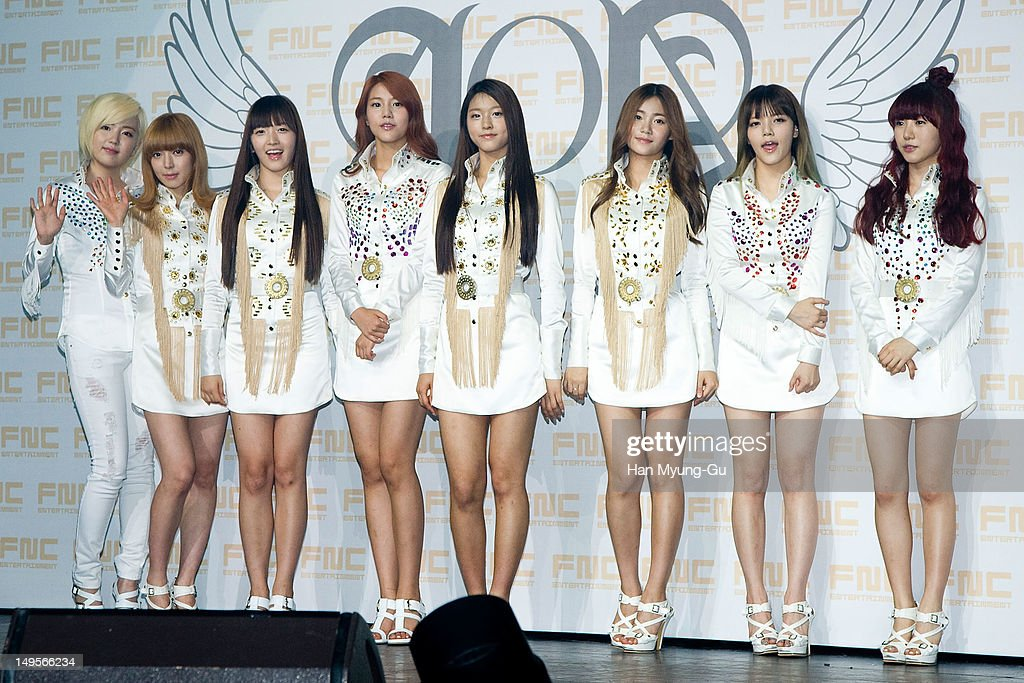 Members of South Korean girl group AOA (Ace of Angels) pose for media during the opening of his 1st single album showcase named 'Angels' Story' on July 30, 2012 in Seoul, South Korea.