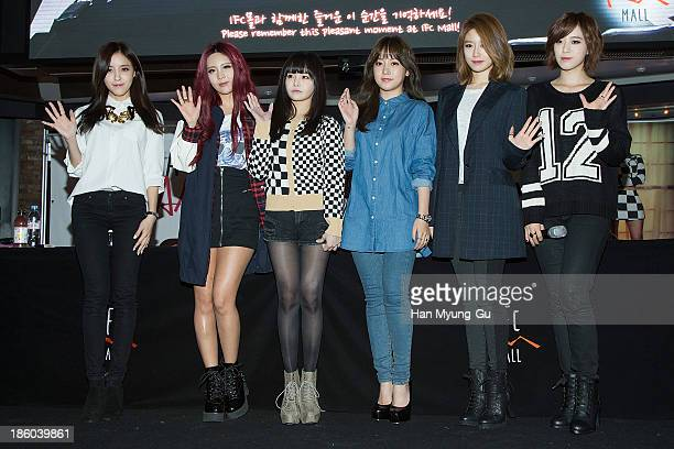 Members of South Korean girl group Tara pose for media at their 8th Mini Album 'Again' record release signing at IFC Mall on October 27 2013 in Seoul...