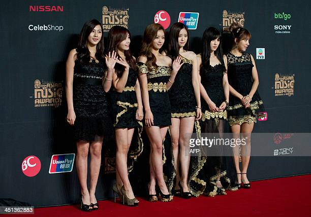 Members of South Korean KPOP girl band APink arrive on the red carpet ahead of the start of the Mnet Asian Music Awards at AsiaWorld Expo in Hong...