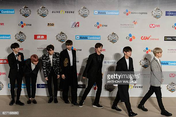 Members of South Korean Kpop group BTS also known as Bangtan Boys leave the red carpet at the Mnet Asian Music Awards at AsiaWorld Expo in Hong Kong...
