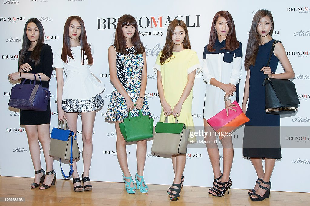 Members of South Korean model attend during the 'Bruno Magli' atelier store grand opening in Seoul on August 16, 2013 in Seoul, South Korea.