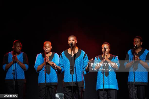 Members of SouthAfrican band Ladysmith Black Mambazo perform live on stage on stage at Columbia Theater on July 20 2018 in Berlin Germany
