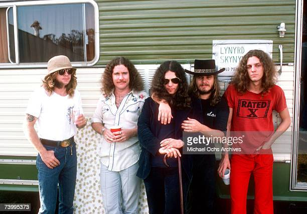 Members of Southern Rock band Lynyrd Skynyrd pose by their trailer backstage at an outdoor concert in October 1976 in California