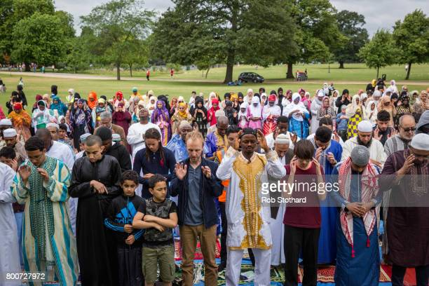 Members of Southwark's Muslim community pray during Eid celebrations in Dulwich Park on June 25 2017 in London England Hundreds gathered in Dulwich...