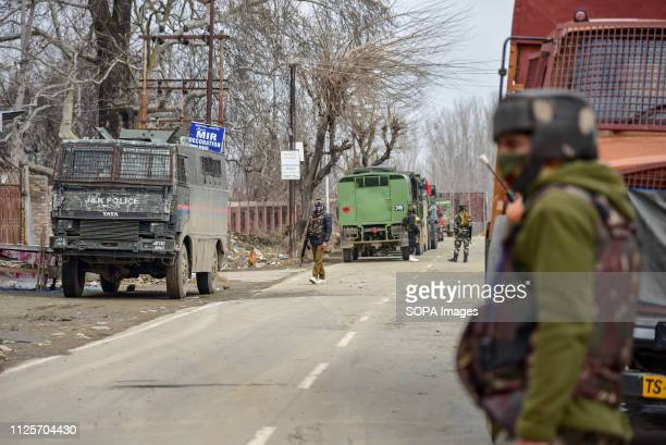 Members of special operation group are seen guarding a street near gun battle site at Pinglena village of South Kashmir's Pulwama district Three...