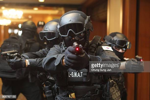 Members of Special Weapons and Tactics team who are employees of Lotte Group take part in an antiterror drill at the Lotte Hotel on January 20 2016...