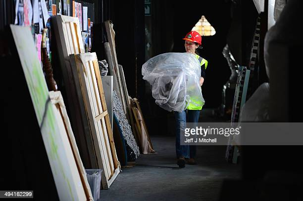 Members of staff and specialist removers continue the retrieval of student art work from the Glasgow School of Art on May 28 2014 in Glasgow Scotland...