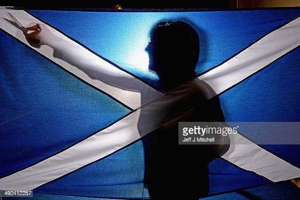 Members of staff at James Stevenson Flags hold a Union Jack and Saltire flag on May 20 2014 in Glasgow Scotland A referendum on whether Scotland...