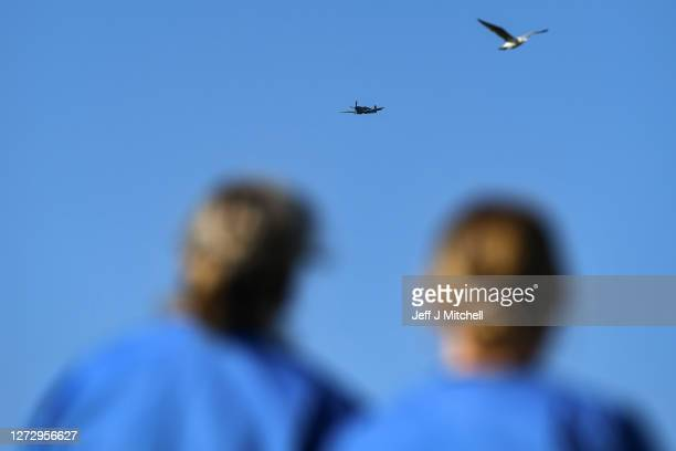Members of staff at the Edinburgh Royal Infirmary watch a vintage Spitfire make a fly past on September 17 2020 in Edinburgh Scotland The Spitfire...