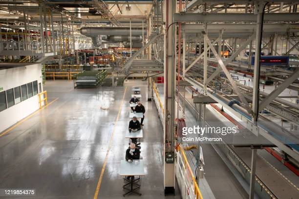 Members of staff at the Vauxhall car factory demonstrating distancing measures necessary when on a break during preparedness tests and redesign ahead...