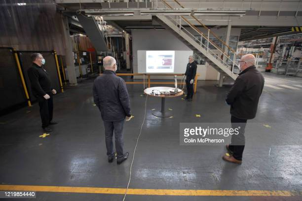 Members of staff at the Vauxhall car factory taking part in a meeting office during preparedness tests and redesign ahead of reopening following the...