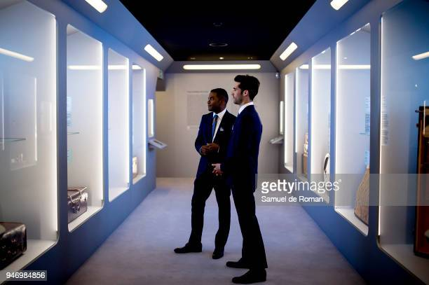 Members of staff look at a work by Loewe 'Time Capsule' by Louis Vuitton Exhibition on April 16 2018 in Madrid Spain