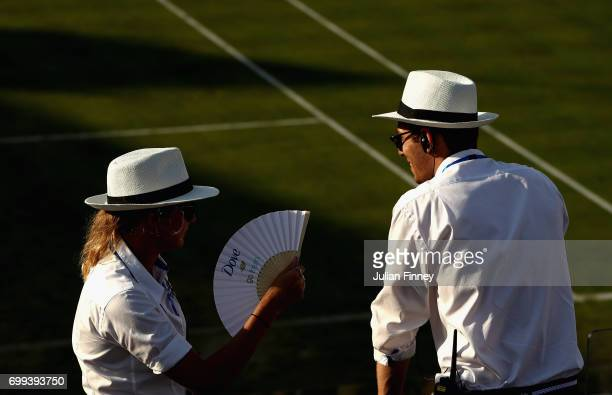 Members of staff look over centre court as they cool down from the heat on day three of the 2017 Aegon Championships at Queens Club on June 21 2017...