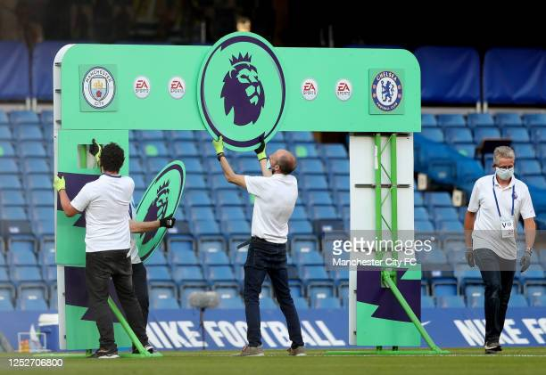 Members of staff put together the premier league hand shake board during the Premier League match between Chelsea FC and Manchester City at Stamford...