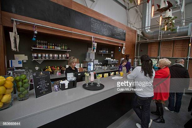 Members of staff serving drinkers in The Brink a nonalcohol bar and restaurant in Parr Street Liverpool The charityrun establishment was opened at...