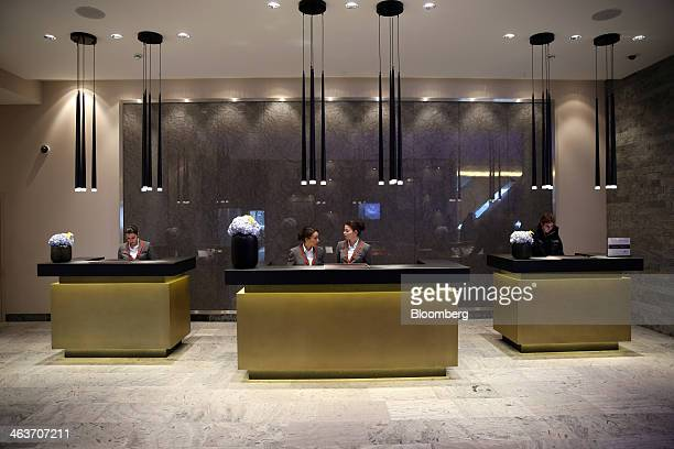 Members of staff stand at reception desks inside the InterContinental hotel Davos operated by InterContinental Hotels Group Plc in Davos Switzerland...