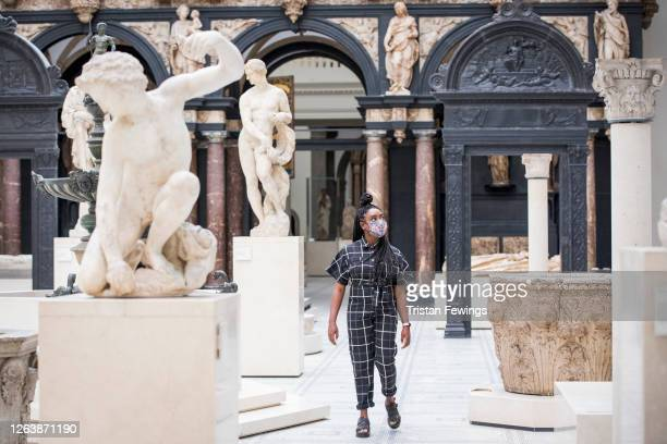 Members of staff walk through the galleries ahead of the reopening of the V&A at The V&A on August 04, 2020 in London, England. The V&A reopens after...