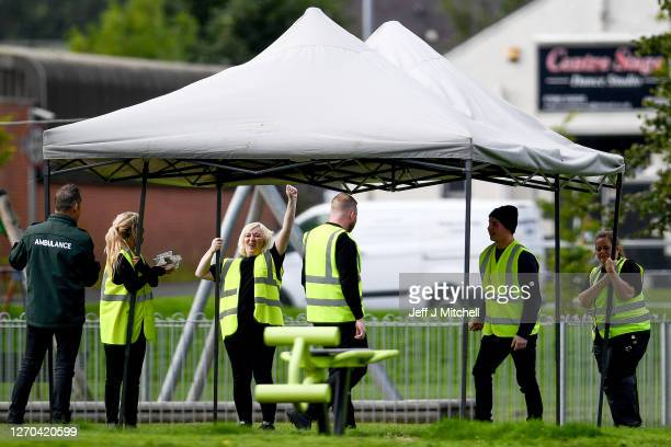 Members of staff work at a coronavirus mobile testing centre in West Dunbartonshire on September 3 2020 in Dumbarton Scotland Starting last night...