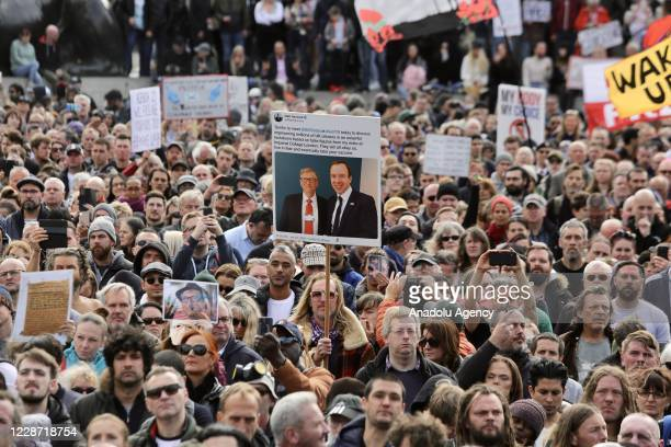 Members of StandUpX, a community of people protesting vaccination and coronavirus measures, gather at Trafalgar Square during a mass rally against...