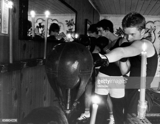 Members of Stockton Amateur Boxing Club Craig Heaviside 15 Graham Hindmarsh 18 and Michael Harrison 16 train by candlelight as the clubs temporary...