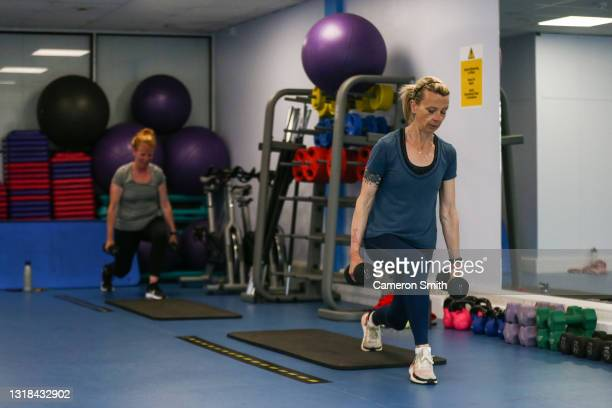 Members of Stringer's Gym take part in a fitness class on May 17, 2021 in Truro, England. England implements the third step in its road map out of...