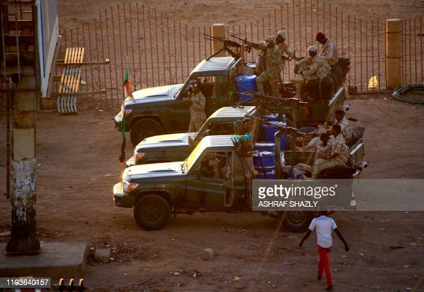 Members of Sudan's intelligence services shoot bullets in the air at the headquarters of the Directorate of General Intelligence Service, in the...