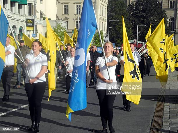 Members of 'Svenskarnas Parti' hold flags during the rally arranged by neoNazi party 'Svenskarnas Parti' at the Kungstradgarden square in central...