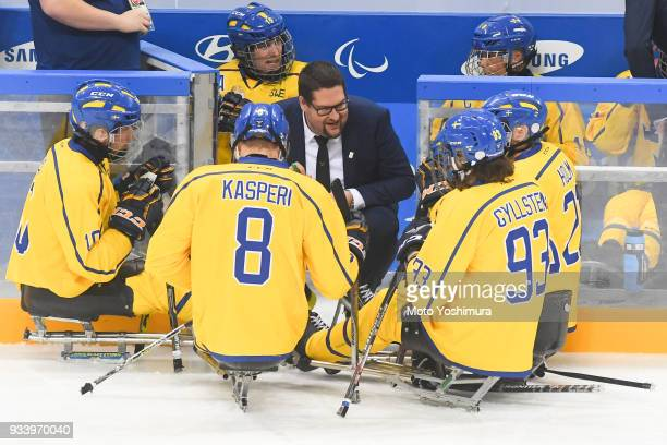 Members of Sweden huddle during the Ice Hockey Classification Game between Japan and Sweden on day seven of the PyeongChang 2018 Paralympic Games on...