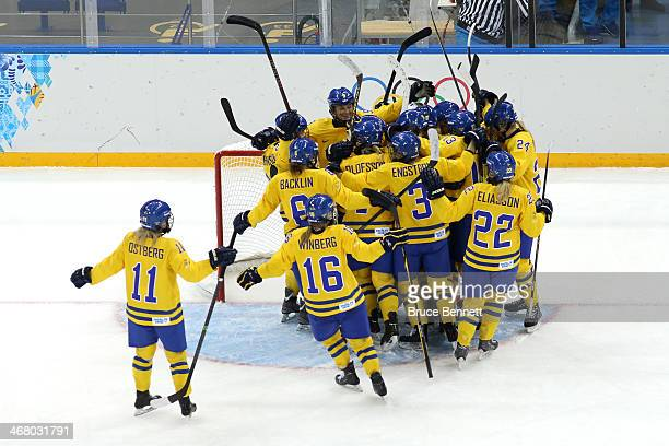 Members of Sweden ice hockey team celebrate their 1-0 win over Japan during the Women's Ice Hockey Preliminary Round Group B Game on day two of the...