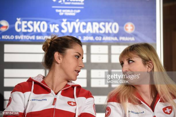 Members of Swiss Fed Cup team Timea Bacsinszky and Belinda Bencic react during the International Tennis Federation Fed Cup draw ceremony on February...