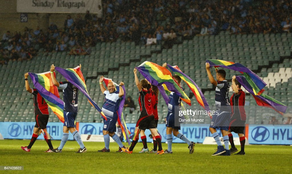 Members of Sydney gay teams Flying Bats Women's FC, and Sydney Rangers FC, hold rainbow flags in celebration of the Sydney Gay and Lesbian Mardi Gras parade ahead the round 22 A-League match between Sydney FC and Melbourne Victory at Allianz Stadium on March 3, 2017 in Sydney, Australia.