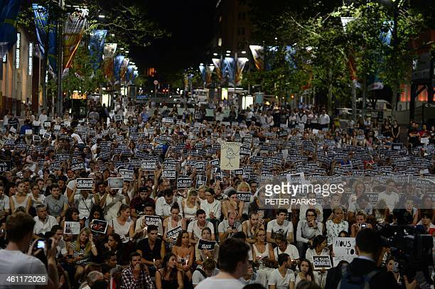Members of Sydney's French community gather in the heart of the city to hold aloft banners reading 'Je Suis Charlie' on January 8 in tribute to the...
