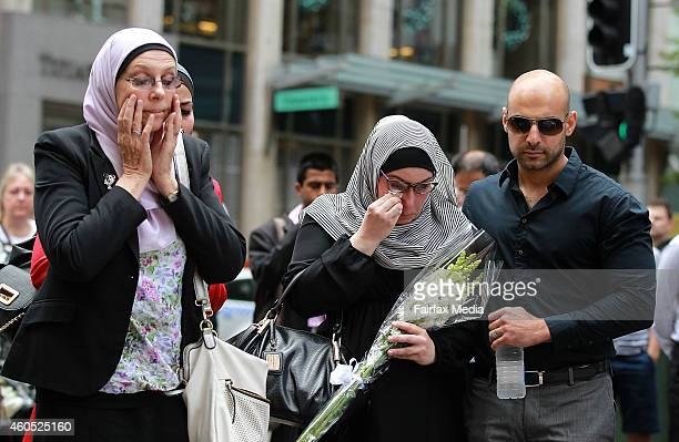 Members of Sydney's Muslim community lay flowers in Martin Place for the two hostages killed during a siege in the nearby Lindt Chocolat Café at...