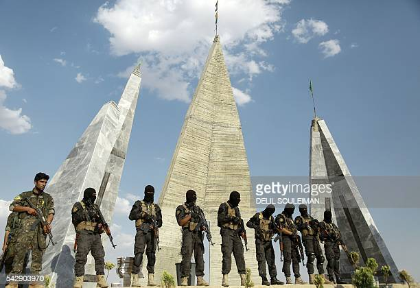 Members of Syrian Democratic Forces attend the funeral of eight fellow fighters who died during an assault against the Islamic State group in the...