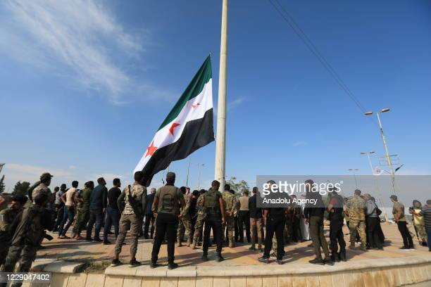 Members of Syrian National Army attend an event to mark the first year of Operation Peace Spring as life turned to normal in Tal Abyad Syria on...