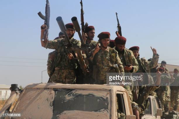 Members of Syrian National Army make their way to enter the territory east of Euphrates River in northern Syria, to support Turkey's Operation Peace...
